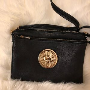 Black purse with gold trim